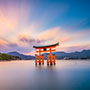 Asia Japan Miyajima Island traditional Itsukushima Shrine floating torii gate at sunset - luxury vacation destinations