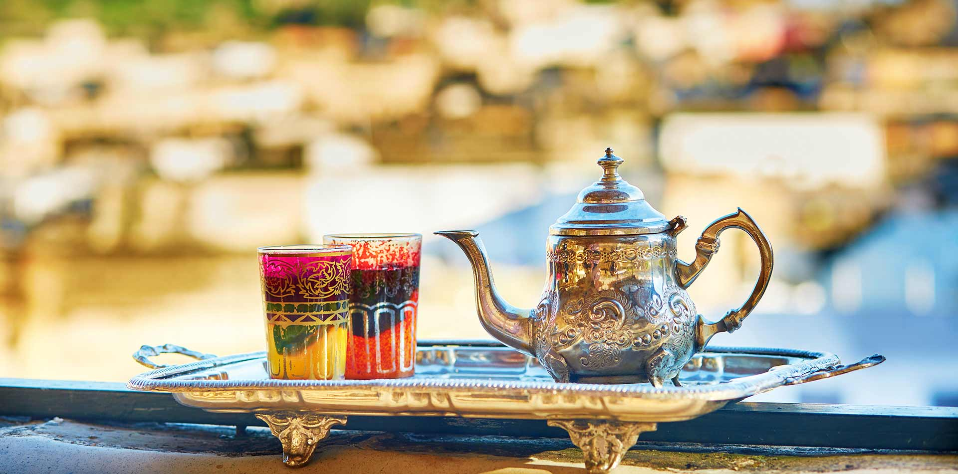 Africa Morocco traditional mint tea colorful glasses decorated silver teapot and tray - luxury vacation destinations
