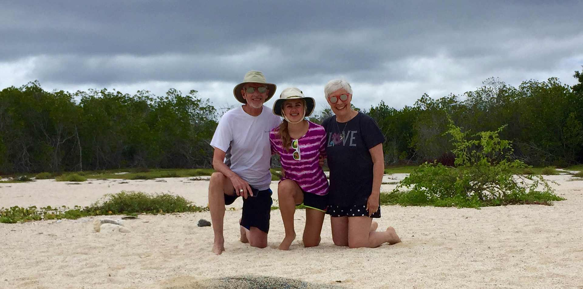 Family on the beach in the Galapagos
