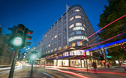 Europe Norway Oslo Continental Hotel exterior at night bright city lights - luxury vacation destinations