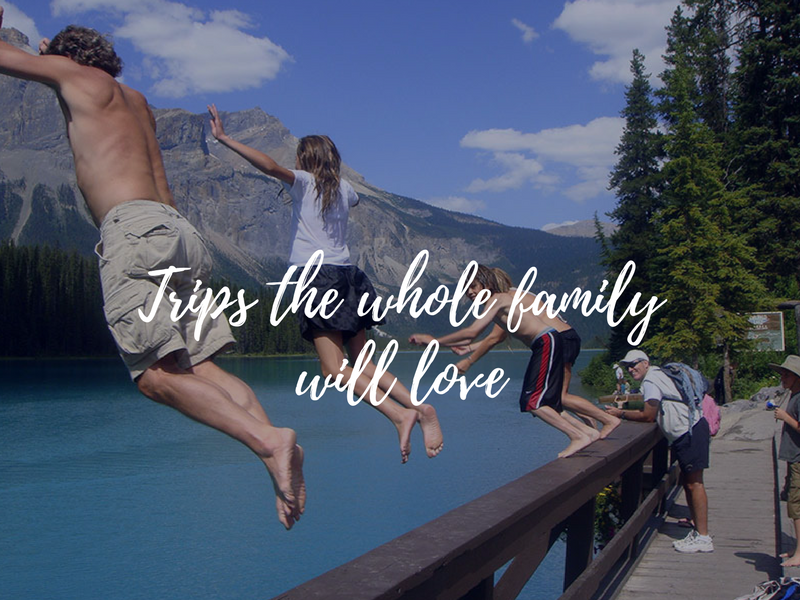 Family jumping into Emerald lake in the Canadian Rockies, Canada