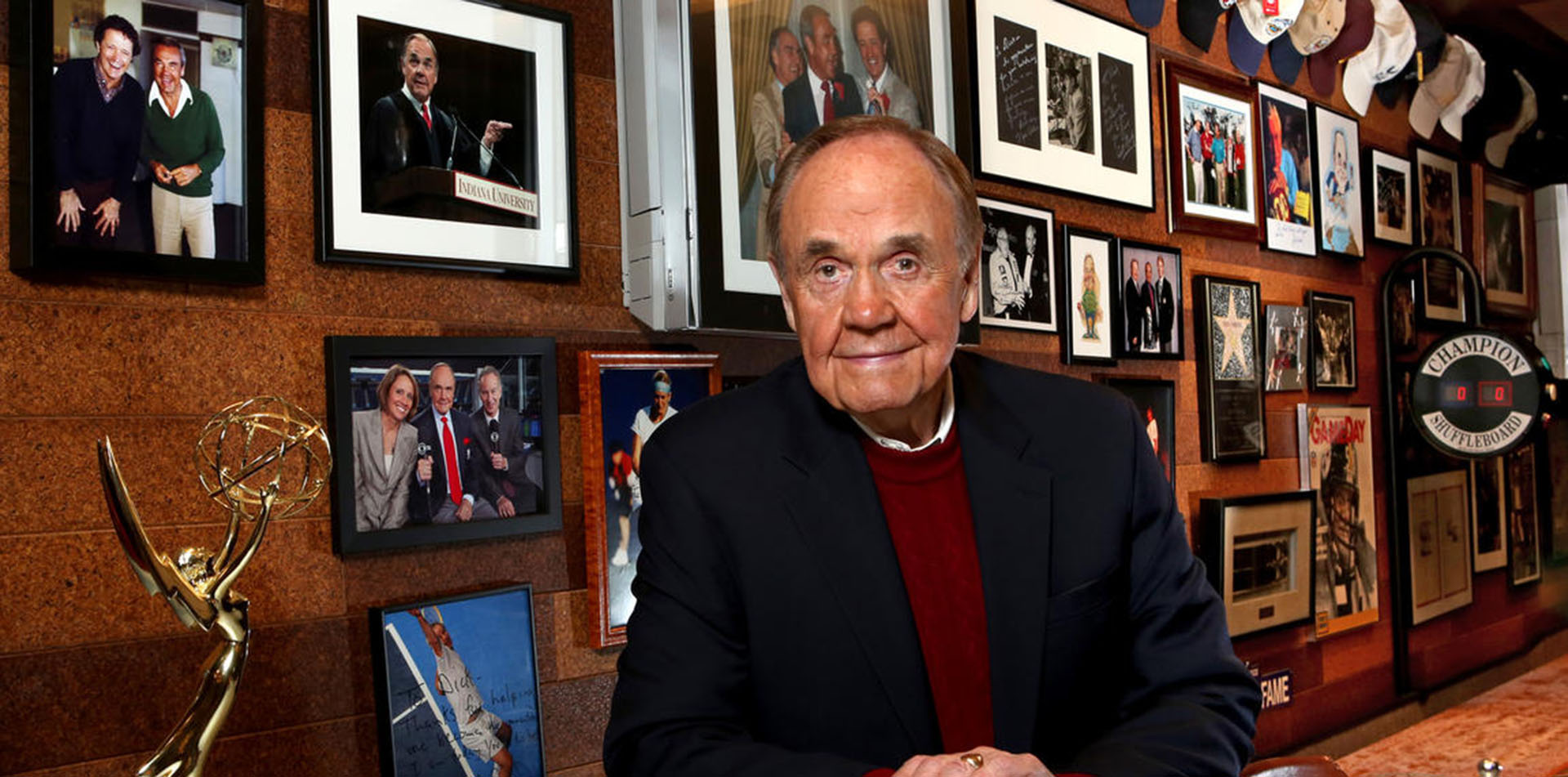 Dick Enberg NBC CBS ESPN sportscaster at home in his man cave with trophies and awards