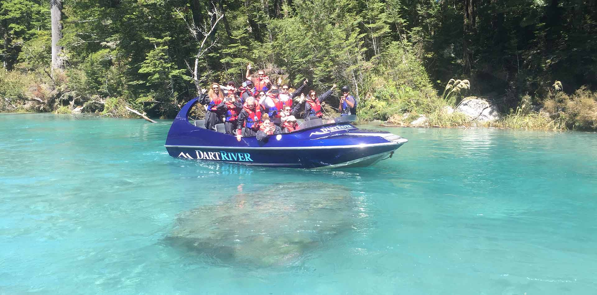 Oceania New Zealand South Island group of people in a jet boat on the Dart River - luxury vacation destinations