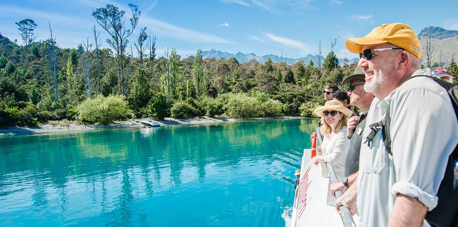 Oceania New Zealand Queenstown people on boat at Mt. Nicholas Farm - luxury vacation destinations