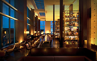 Asia Japan Hilton Conrad Tokyo hotel bar at nighttime with cityscape view - luxury vacation destinations