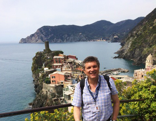 Europe Italy Tuscany Cinque Terre expert local guide at viewpoint overlooking cliffside village - luxury vacation destinations