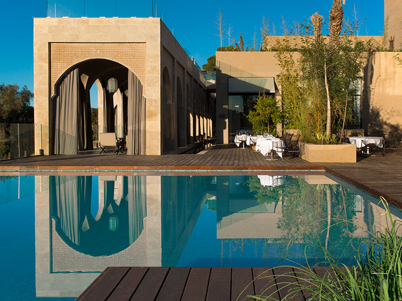 Africa Morocco Fez Hotel Sahrai relaxing reflective rooftop pool Moorish style architecture - luxury vacation destinations