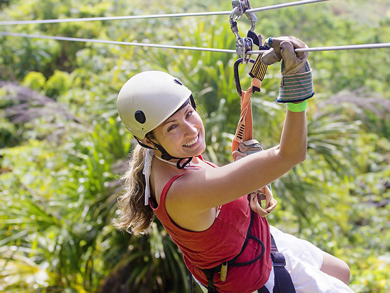 Woman Zip Lining in Costa Rica