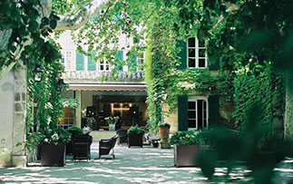 Europe France Hotel Le Prieure Baumaniere Relais & Chateaux Villeneuve-lès-Avignon courtyard - luxury vacation destinations