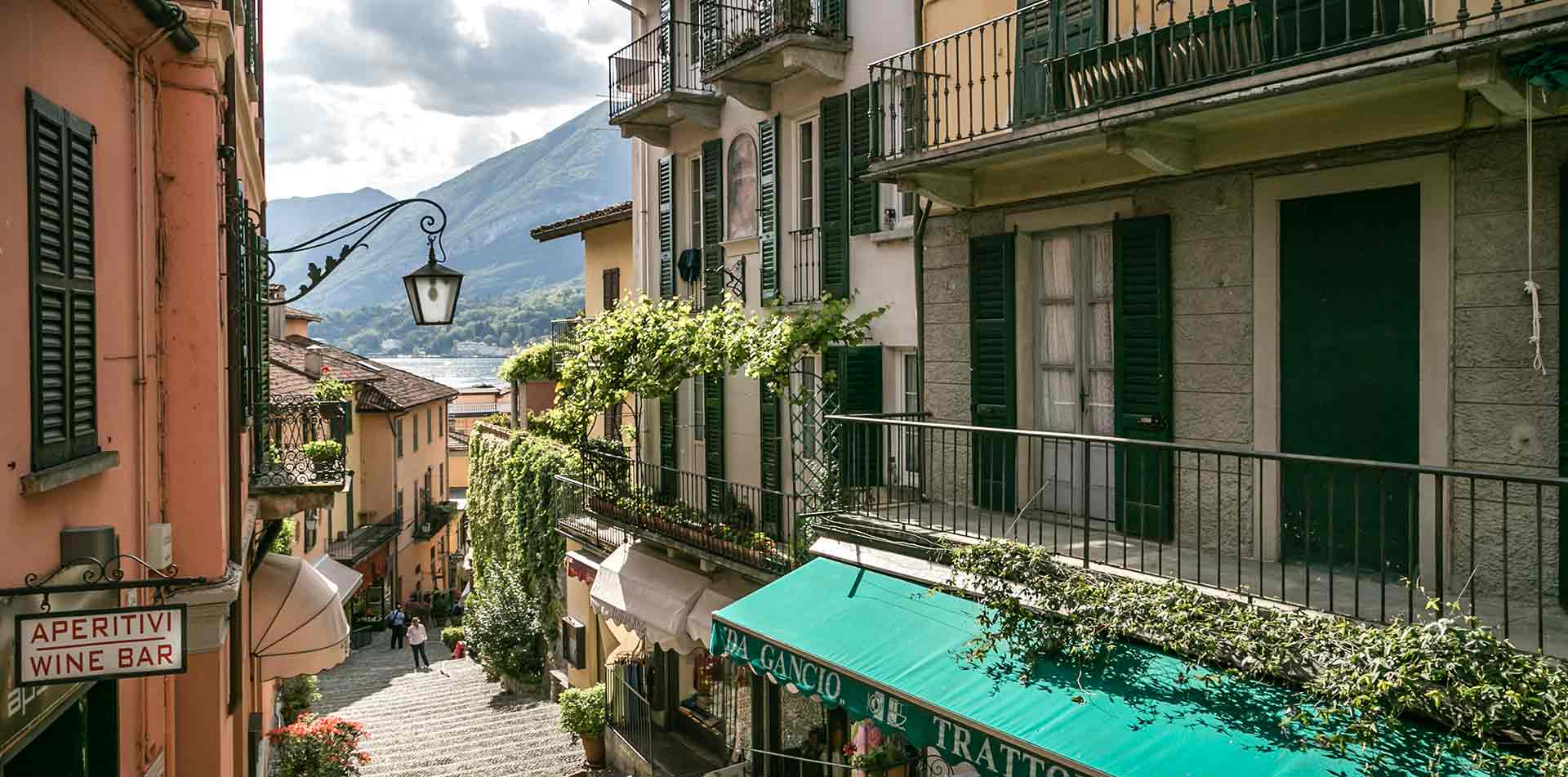 Europe Italy Lake Como Bellagio old bright buildings cobblestone streets green ivy scenic view - luxury vacation destinations