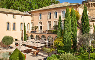 Europe France Provence Chateau de Massillan courtyard patio during daytime - luxury vacation destinations