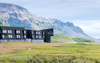 Europe Iceland Oraefi Fosshotel Glacier Lagoon modern countryside hotel with mountain backdrop - luxury vacation destinations