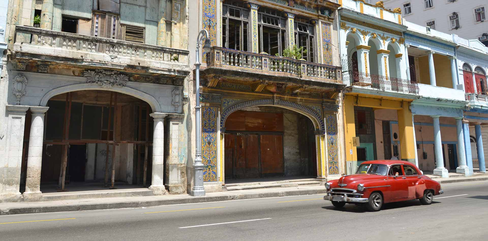 North America Caribbean Cuba Havana old city street red classic car colorful - luxury vacation destinations