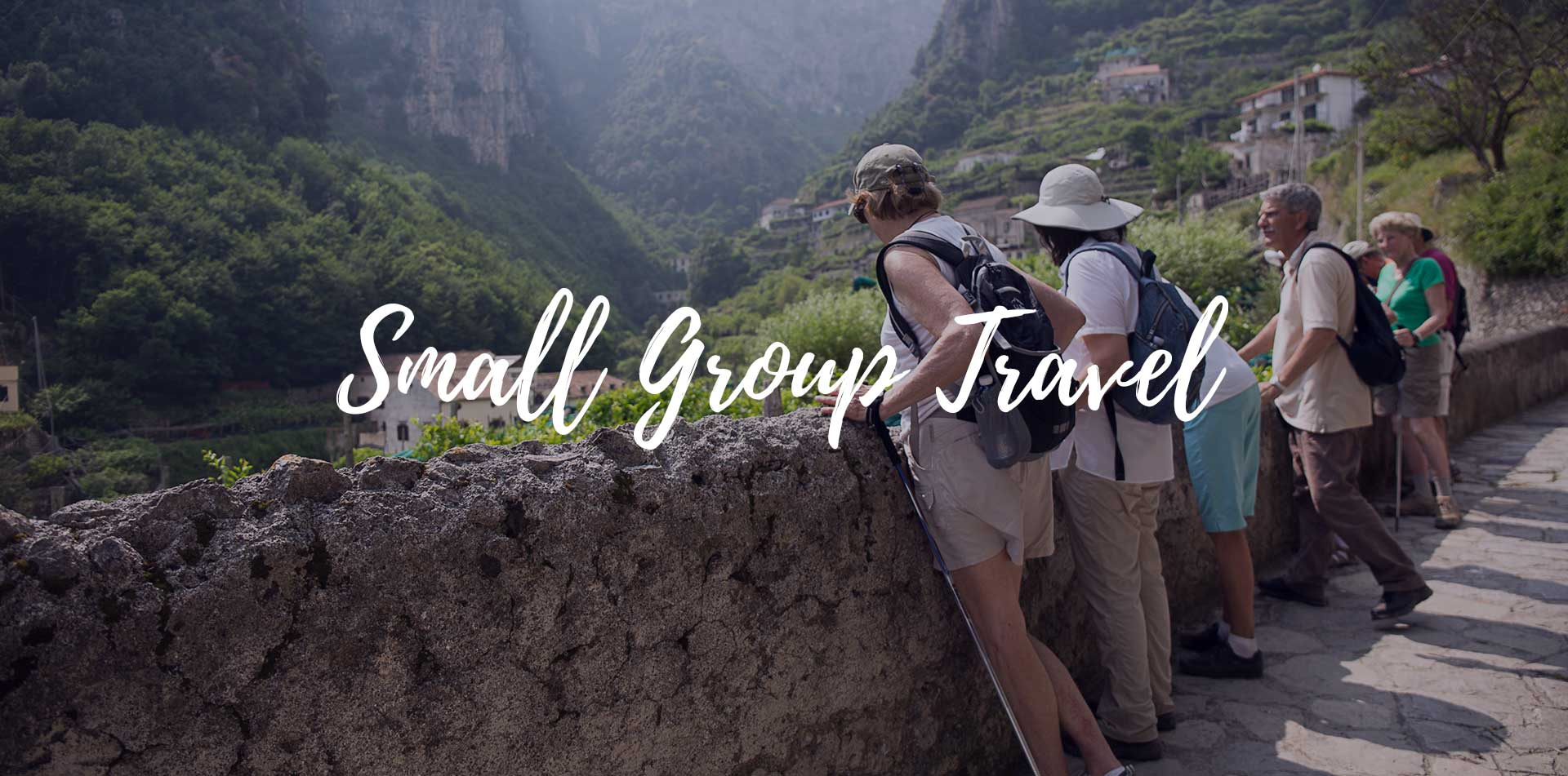 Group of travelers leaning on city wall with local guide small group travel - luxury vacation destinations