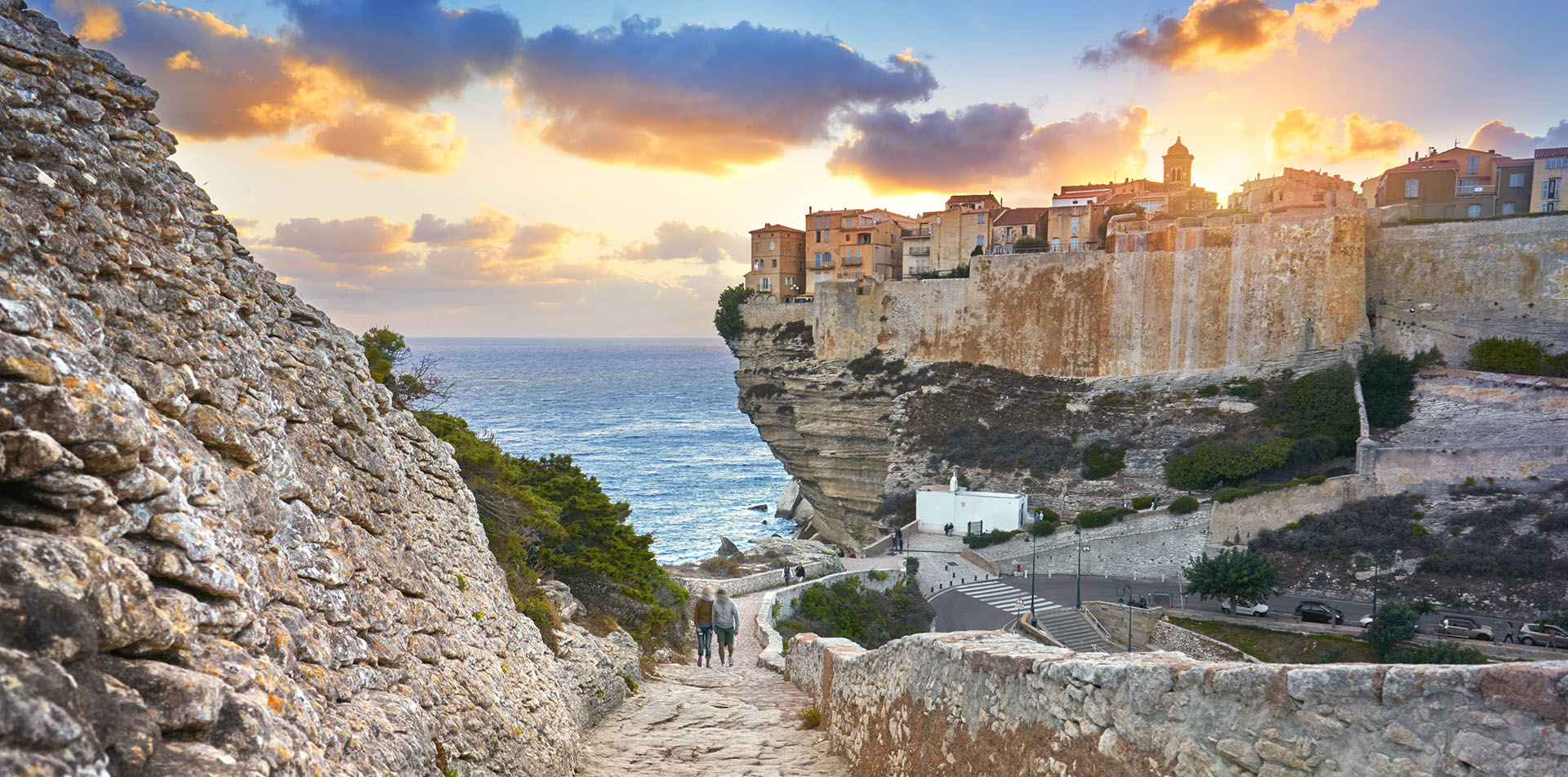 Europe Sardinia Corsica building on cliffside in Bonifacio at twilight - luxury vacation destinations