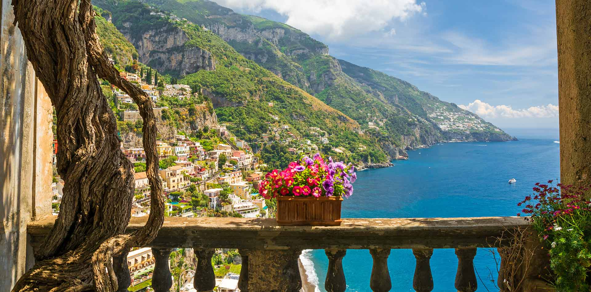 Europe Italy Sorrento Amalfi Coast beautiful balcony with flowers overlooking ocean - luxury vacation destinations