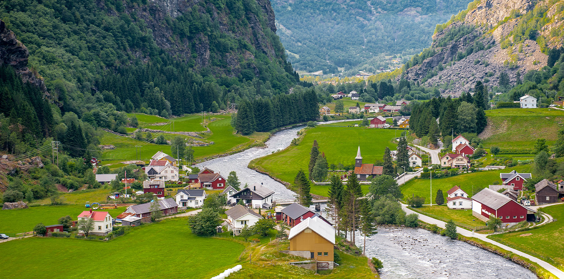 Europe Norway village of Flam along the river in fjord lands - luxury vacation destinations